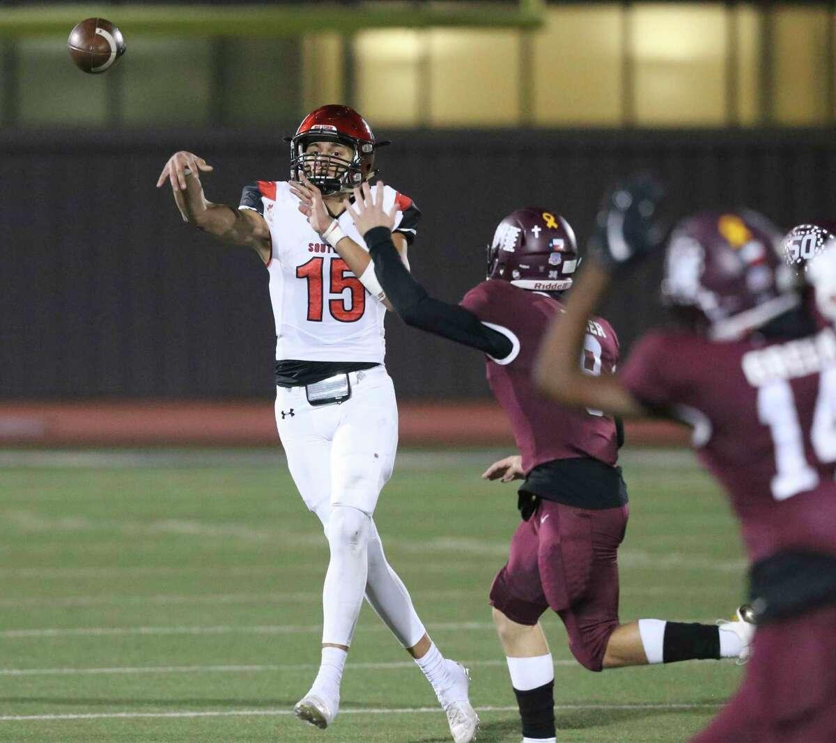 Cardinal quarterback Richard Torres picks a receiver as Southside plays Flour Bluff in high school football playoffs at Alamo Stadium on Dec. 17, 2020.