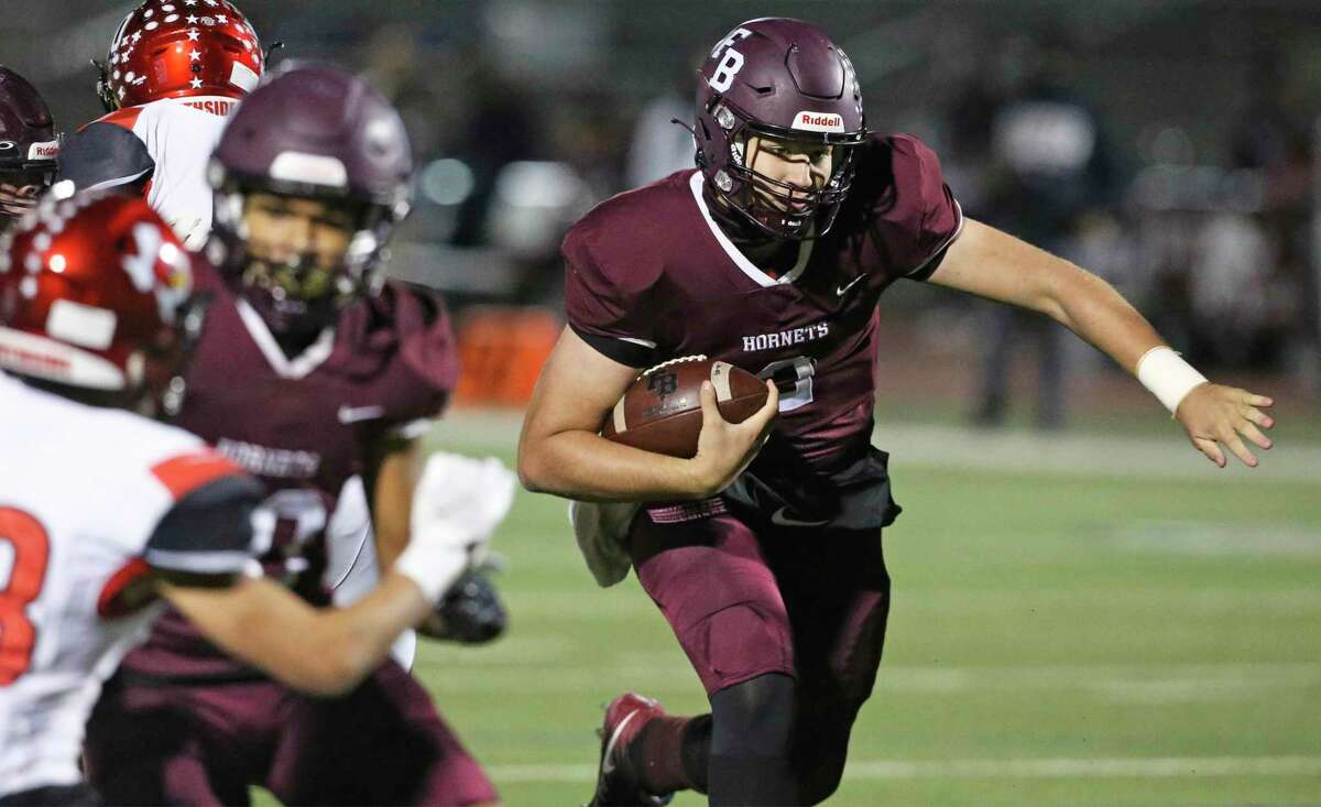 The Hornets quarterback Nash Villegas bypasses the defense in the middle as Southside plays Flour Bluff in the high school playoffs at Alamo Stadium on December 17, 2020.