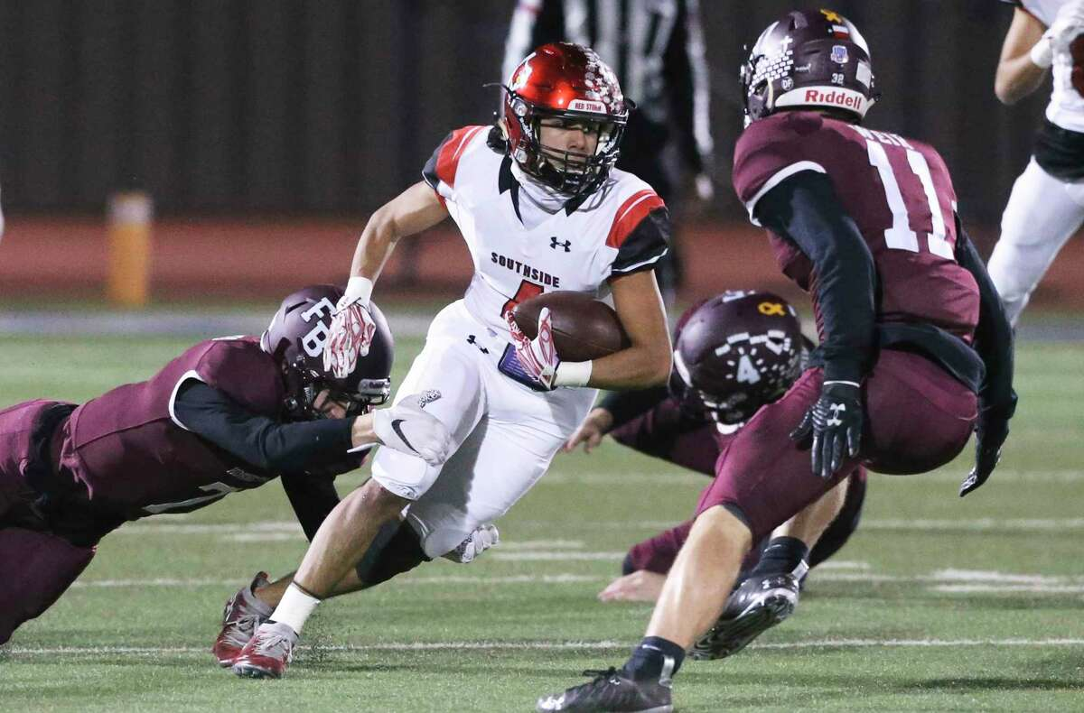 Matthew Reyes returns for the Cardinals when Southside plays Flour Bluff in the high school playoffs at the Alamo Stadium on December 17, 2020.