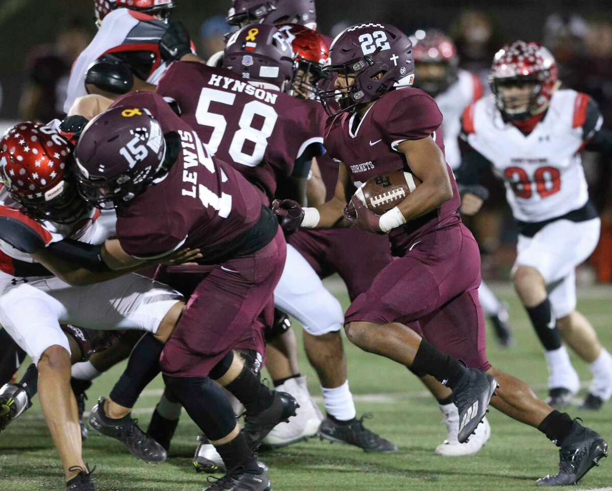 The Hornet running back Isaac Miles follows a block down the middle as Southside plays Flour Bluff in the high school playoffs at Alamo Stadium on December 17, 2020.