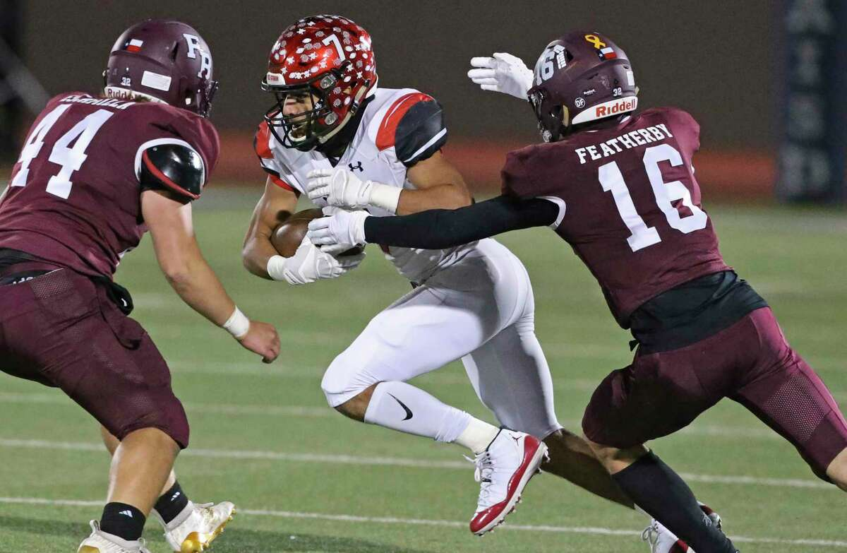 Cardinal Caleb Camarillo kicks out defenders as Southside plays Flour Bluff in the high school playoffs at Alamo Stadium on December 17, 2020.