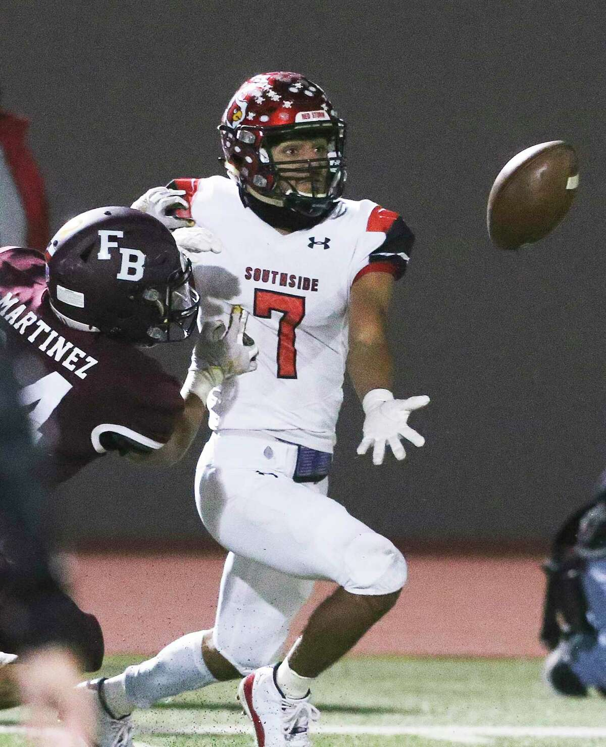 Caleb Camarillo struggles to get to the ball on a long pass for the Cardinals as Southside faces Flour Bluff in the high school playoffs at Alamo Stadium on December 17, 2020.