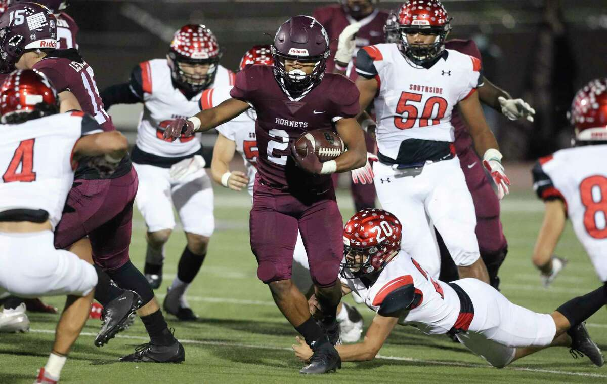 Isaac MIles, who runs back the Hornet, battles the Cardinal Defense in the first half as Southside faces Flour Bluff in the high school playoffs at Alamo Stadium on December 17, 2020.