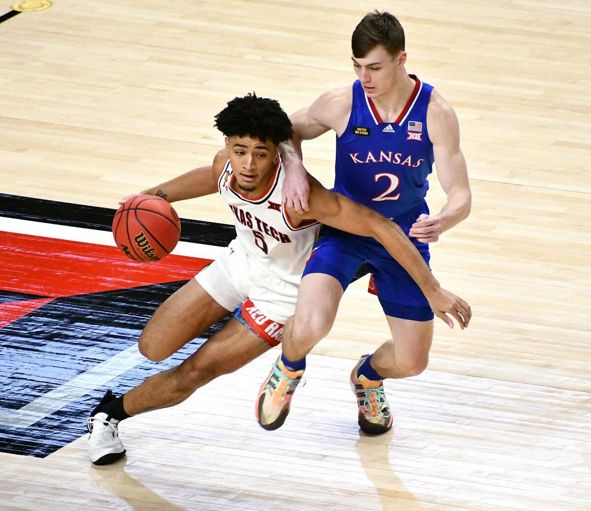 The 14th-ranked Texas Tech Red Raiders suffered a 58-57 loss to 5th-ranked Kansas in a Big 12 men's basketball game on Dec. 17, 2020 in the United Supermarkets Arena in Lubbock.