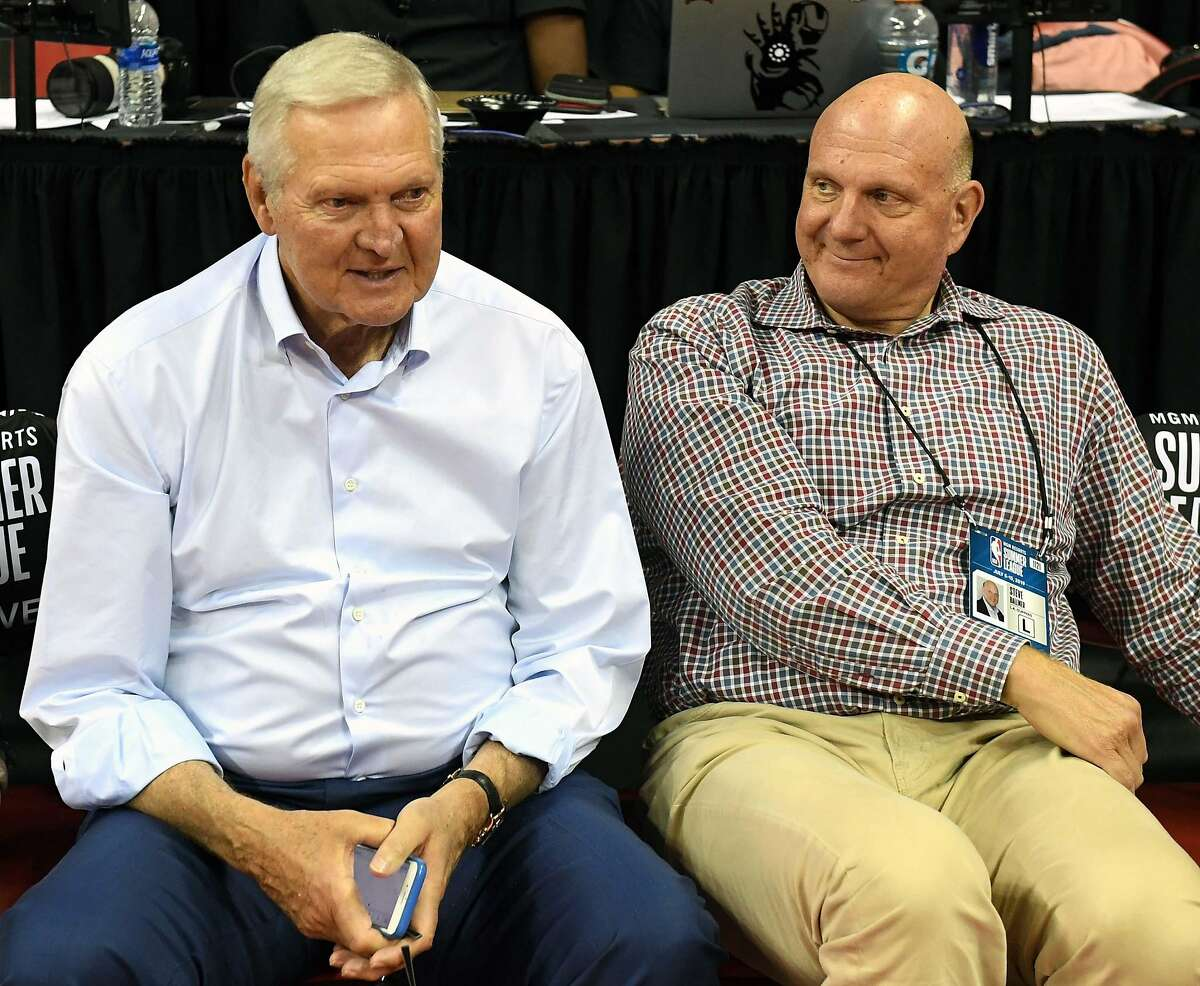 Clippers consultant Jerry West (left), with owner Steve Ballmer, denied offering $2.5 million to lure Kawhi Leonard.