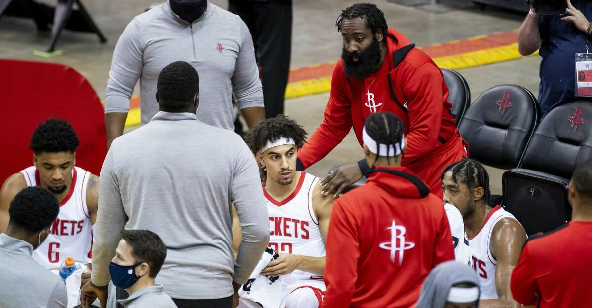 Houston Rockets guard James Harden (13) joins the huddle talking to Houston Rockets guard Brodric Thomas (33) during the fourth quarter of a preseason NBA basketball game between the Houston Rockets and the San Antonio Spurs on Thursday, Dec. 17, 2020, at Toyota Center in Houston.
