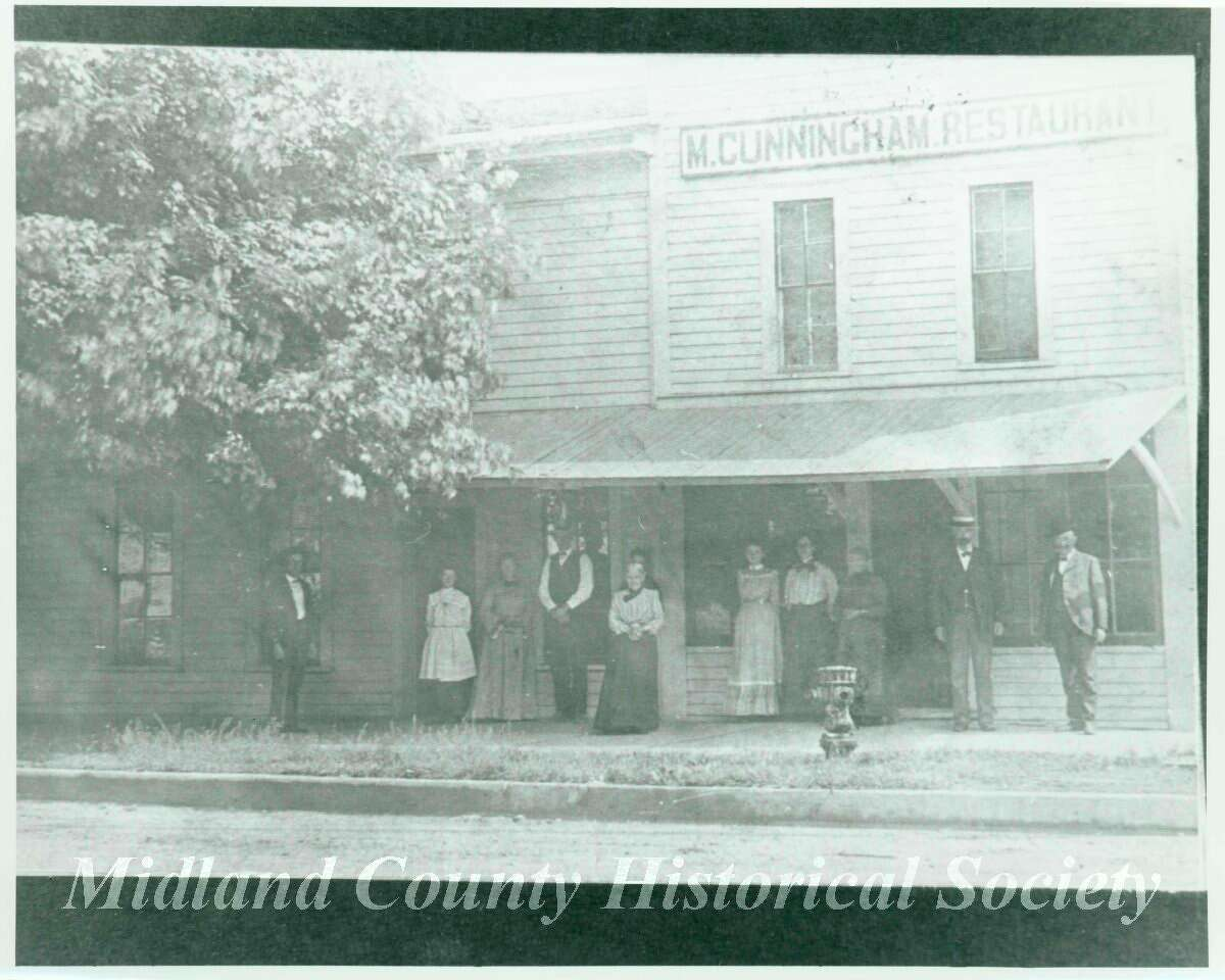 Maggie Cunningham stands in front of her hotel and restaurant. (Provided Photo)
