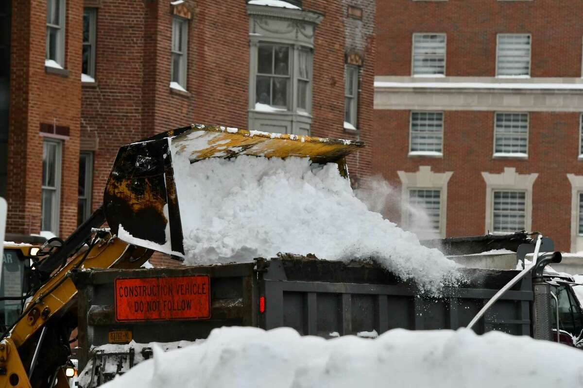 Snow removal crews get to work Friday on Washington Avenue by the Capitol and City Hall in Albany. The region is facing a lengthy cleanup after a powerful nor'easterdropped heavy snow across upstate on Thursday.