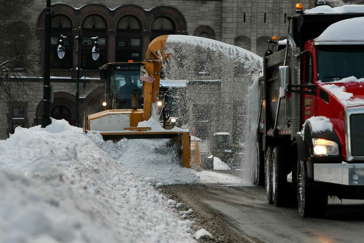Snow removal crews get to work Friday on Washington Avenue by the Capitol and City Hall in Albany. The region is facing a lengthy cleanup after a powerful nor'easter dropped heavy snow across upstate on Thursday.