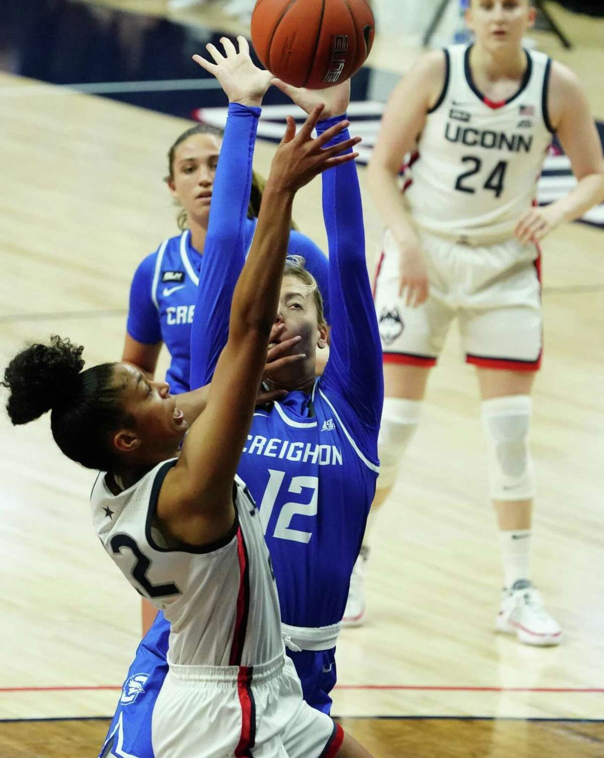 UConn's Evina Westbrook (22) drives to the basket against Creighton's Gracey Griglione (12) on Thursday in Storrs.
