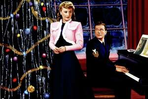 "Barbara Stanwyck and Dennis Morgan are seen in a poster for 1945's ""Christmas in Connecticut."" It's believed Stanwyck's character, Elizabeth Lane, was loosely based on Gladys Taber, a popular columnist at the time for magazines such as Ladies' Home Journal. Taber, who lived at Stillmeadow Farm in Southbury, wrote nearly 60 books and a column in the 1930s and 1940s called ""Diary of Domesticity."" Elizabeth Lane's column is ""Diary of a Housewife,"" but it's a sham. She can't cook and doesn't live on a farm. The romantic comedy follows what happens when she pretends to be what she isn't, and falls in love with one of her fans, war hero Jefferson Jones, played by Morgan."