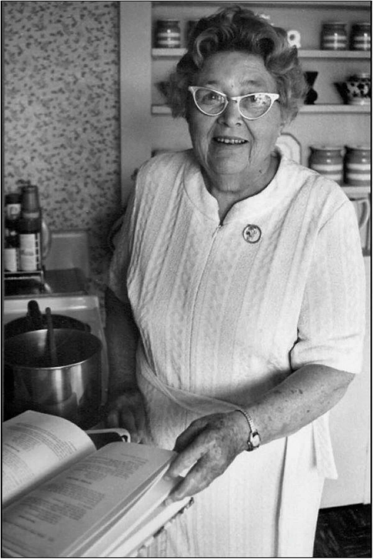 Gladys Taber, cooking in her kitchen at Stillmeadow Farm in Southbury, is seen in a photo which hangs in the office of Susan J. Turnley, editor of FOGT (Friends of Gladys Taber) Quarterly Journal.