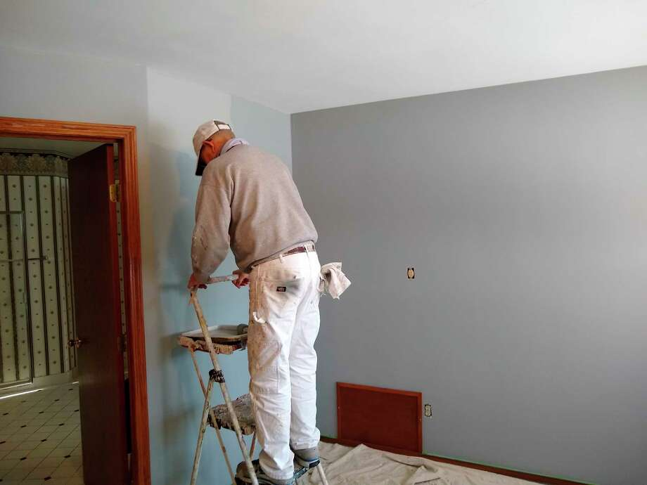 Dave Crockett puts on a fresh coat of paint at the senior center's new location.(Courtesy photo)