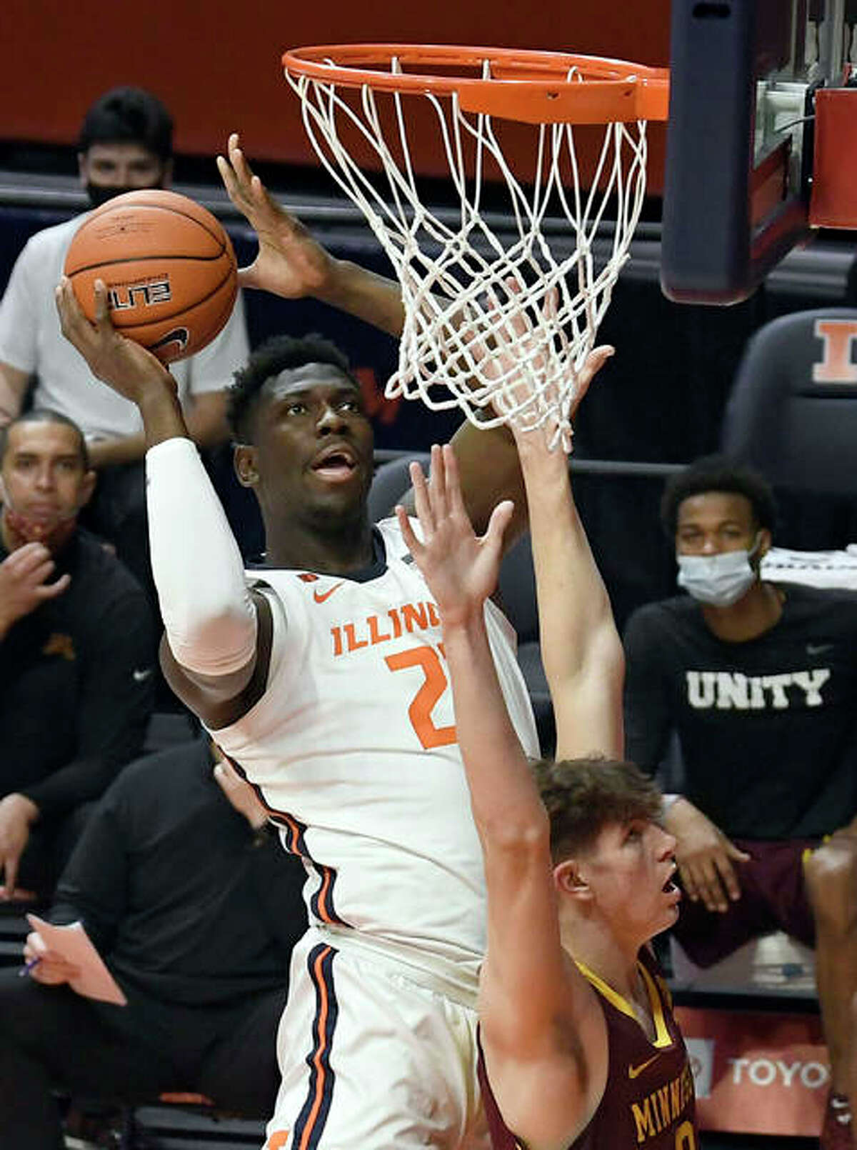 Illinois center Kofi Cockburn (21) puts the ball up as Minnesota's center Liam Robbins (0) defends in the first half of an NCAA college basketball game Tuesday, Dec. 15, 2020, in Champaign, Ill.
