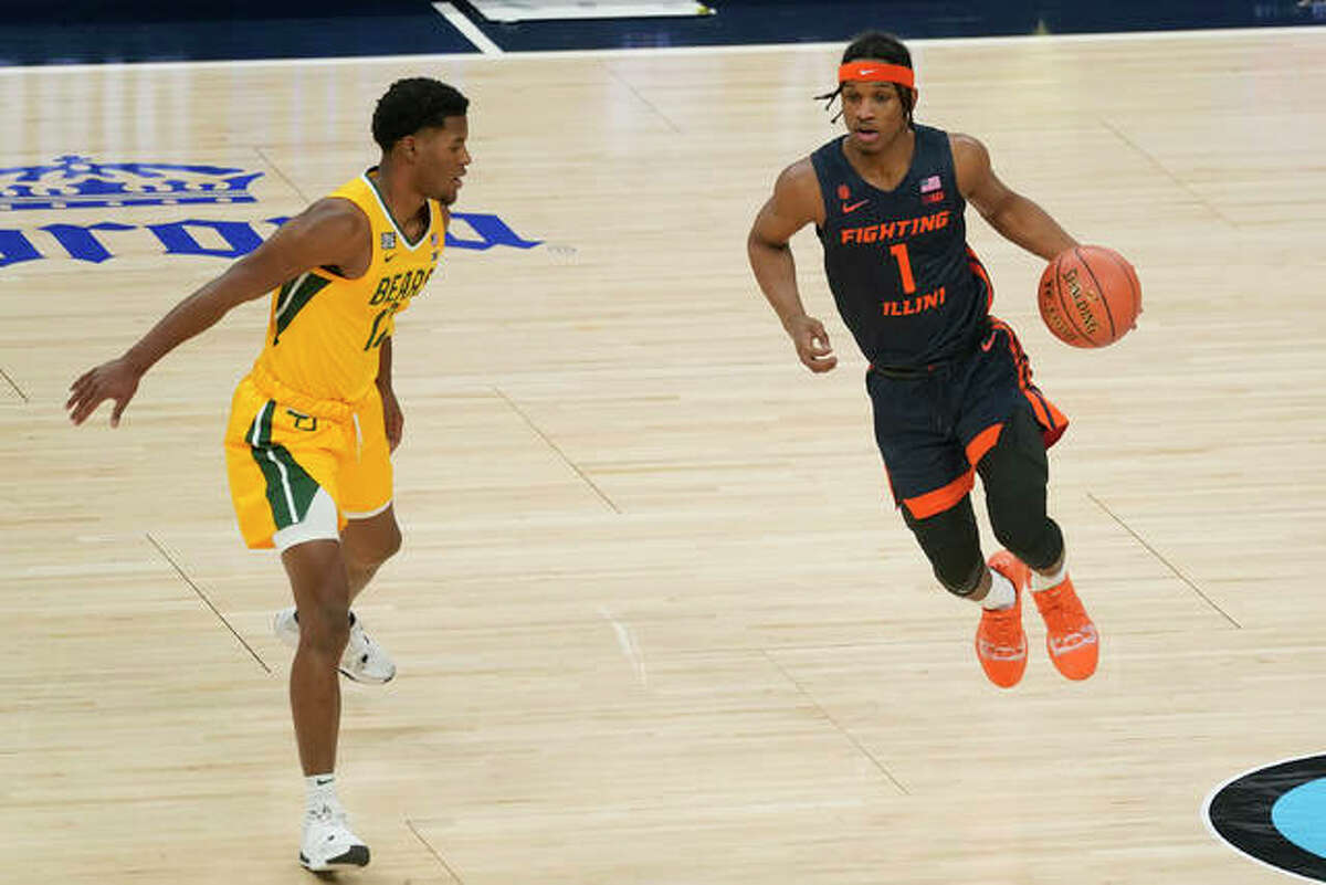 Illinois' Trent Frazier (1) is defended by Baylor's Jared Butler (12) during the first half of an NCAA college basketball game, Wednesday, Dec. 2, 2020, in Indianapolis.