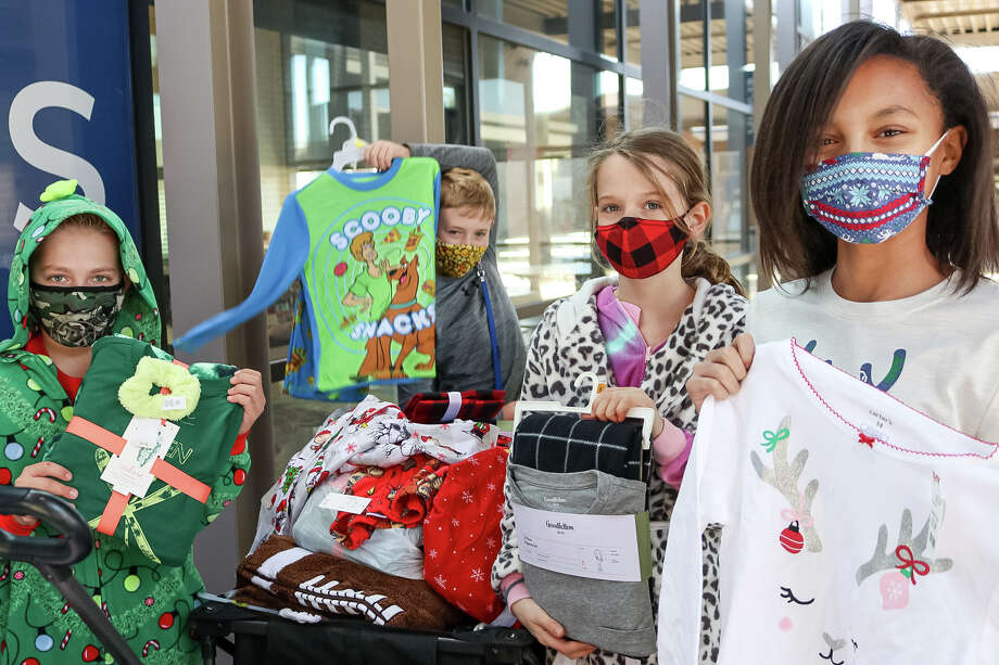 Trinity School students brought a pair of pajamas in their size to donate to Casa de Amigos. Photo: Photo Courtesy Of Lauren Friday/Trinity School
