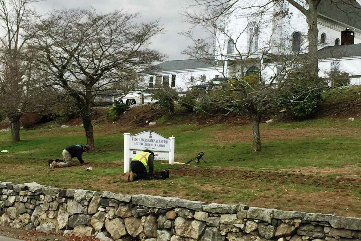 Sullivan Lawn Service crew members keep their eye on the prize - the planting of 5,000 daffodil bulbs on Methodist Hill in Essex Village thanks to the efforts of The Essex Foundation and its project partners.