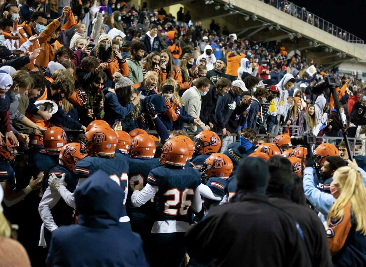 Bridgeland's football team reacts with the crowd after they win 47-44 after a four time overtime play in a Region II-6A (Div. II) area round game at Cy-Fair FCU Stadium on Thursday, Dec. 17, 2020.