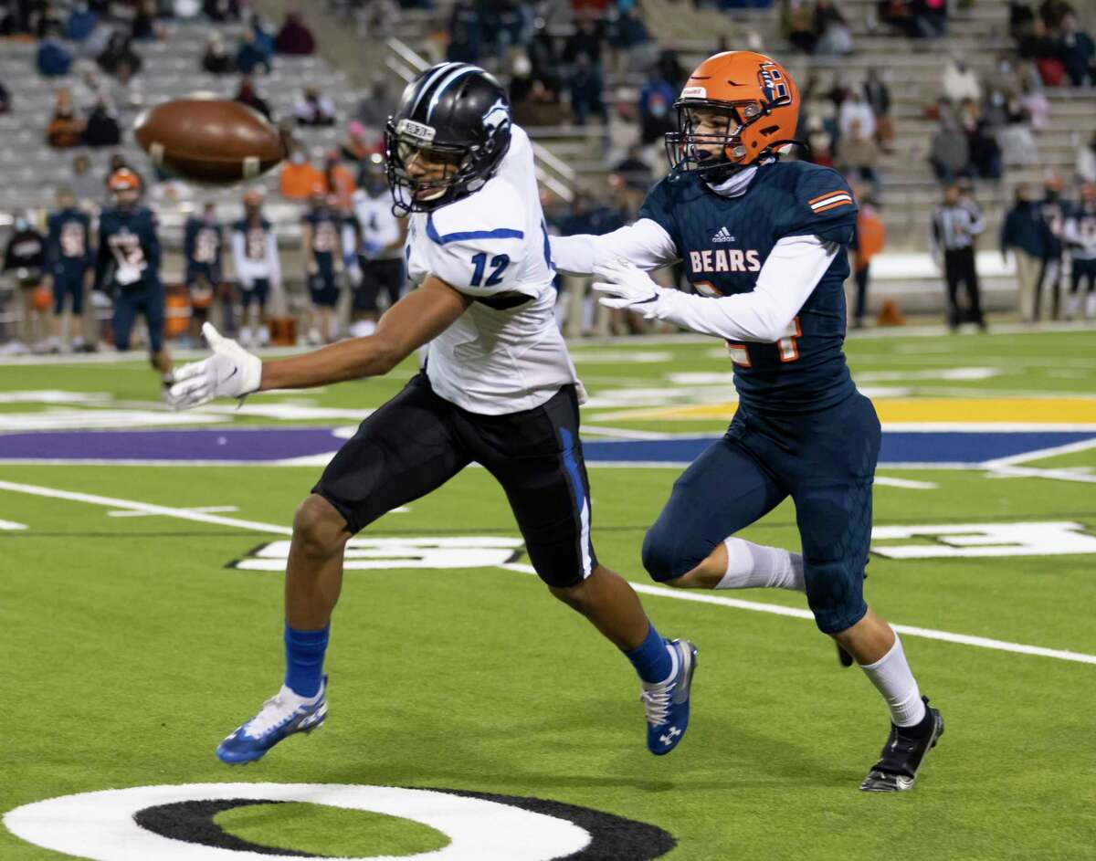 Dekaney wide receiver Jonah Wilson (12) misses a pass as a result of pressure from Bridgeland defensive back Jack Grier (24) during the second quarter of a Region II-6A (Div. II) area round game at Cy-Fair FCU Stadium on Thursday, Dec. 17, 2020.