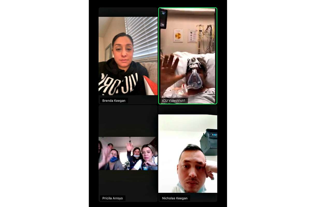 Saying goodbye from afar: José Jesús Arroyo's family members shared a screenshot of one of their final Zoom calls to illustrate the toll the pandemic is taking on families like theirs. On the call with Arroyo (top right) are daughter Brenda Keegan (top left) and son-in-law Nicholas Keegan (bottom right). At bottom left are wife Esther (blue mask), daughter Pricila (waving), daughter Jannette (far right) and son Eliseo (left rear). Arroyo died of COVID-19 this month in a hospital in Riverside County.