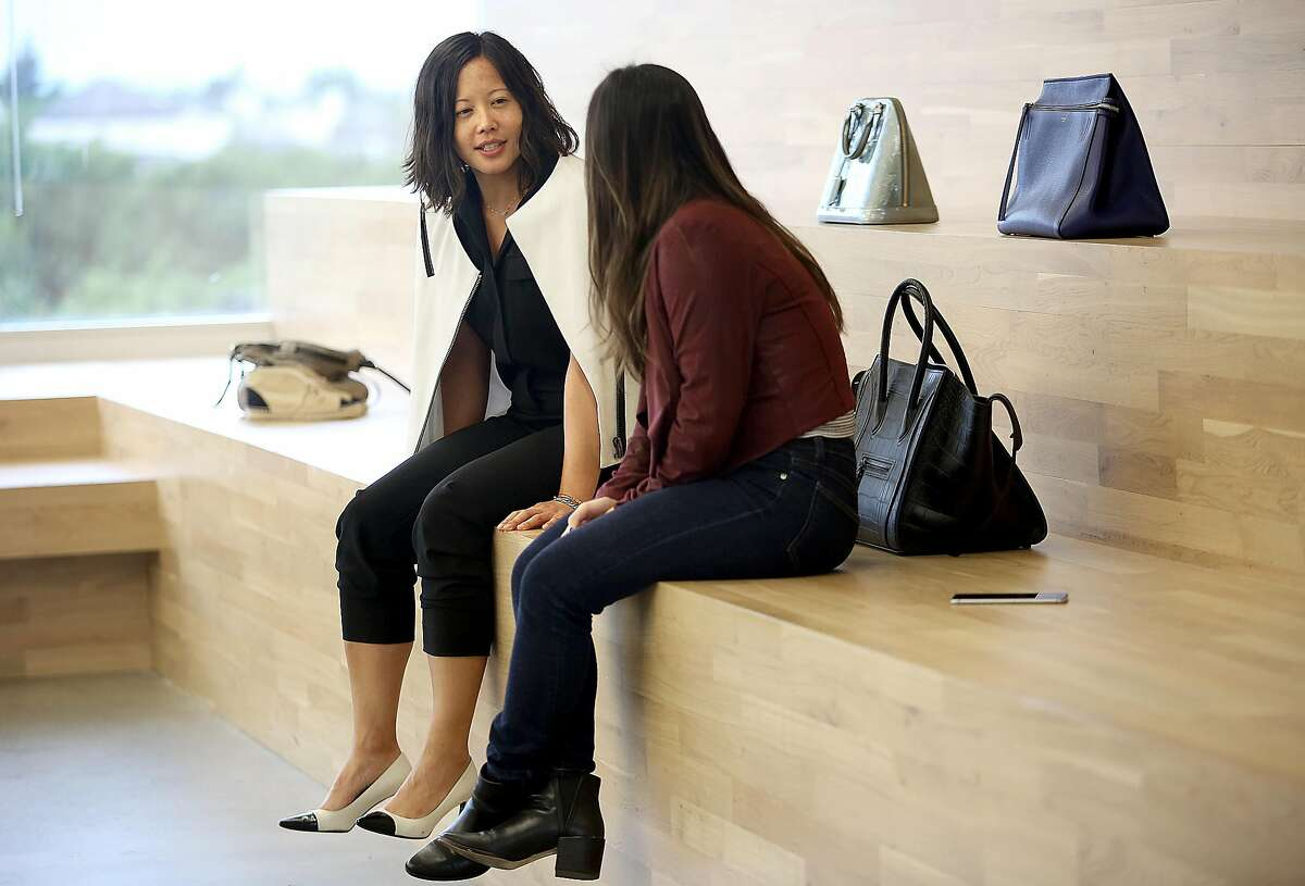 Poshmark co-founder Tracy Sun (left) talks with administrative assistant Amanda Pham in the online reseller's Redwood City office in 2016. It plans to go public.