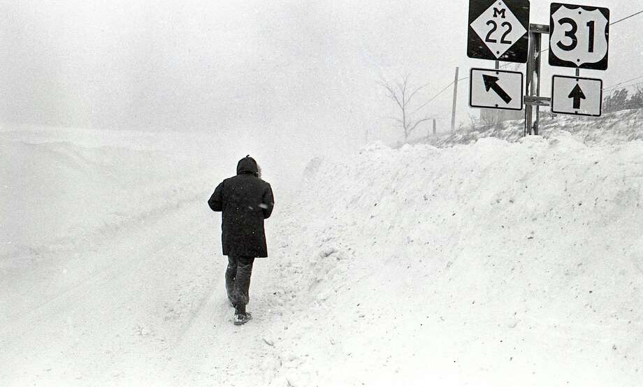 This photo shows a view walking down M-22 after the blizzard of 1978. (Manistee County Historical Museum photo)