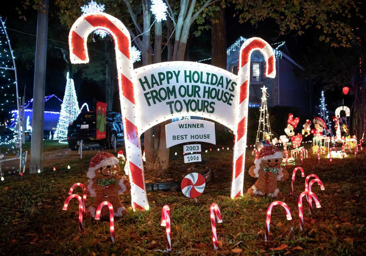 As seen, homes are decorated in Christmas decorations and lights during the annual Nite of Lights event in Prestonwood Forest, Wednesday, Dec. 16, 2020, in Houston. The event draws in thousands of visitors and runs this year from Dec. 12 through Dec. 27