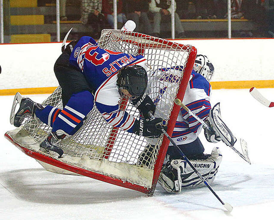 A player collides with the net and upends it onto the goalie during an MVCHA 2A All-Star game at the East Alton Ice Arena. Because of the COVID-19 pandemic, the MVCHSA has cancelled its traditional season and its All-Star Games, but may offer a league tournament in their place. Photo: Telegraph File Photo