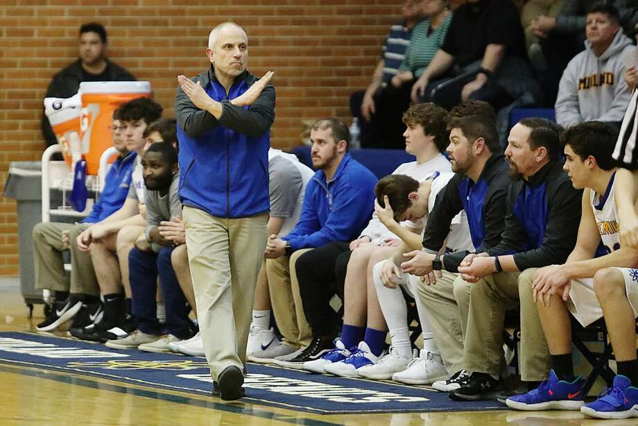Midland High boys' basketball coach Eric Krause calls a play during a Feb. 27, 2019 district game against Dow High. Photo: Daily News File Photo