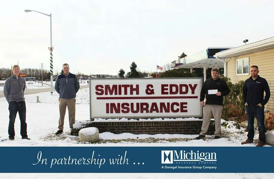 Smith & Eddy Insurance, in partnership with Michigan Insurance Company, makes a donation to theManistee Chippewa 350 Athletic Boosters Club in support of Manistee Area Public Schools athletic programs. Pictured (from left to right) areJustin Papes, Zack Bialik, Mark Sandstedt and Nick Fortier. (Courtesy photo)