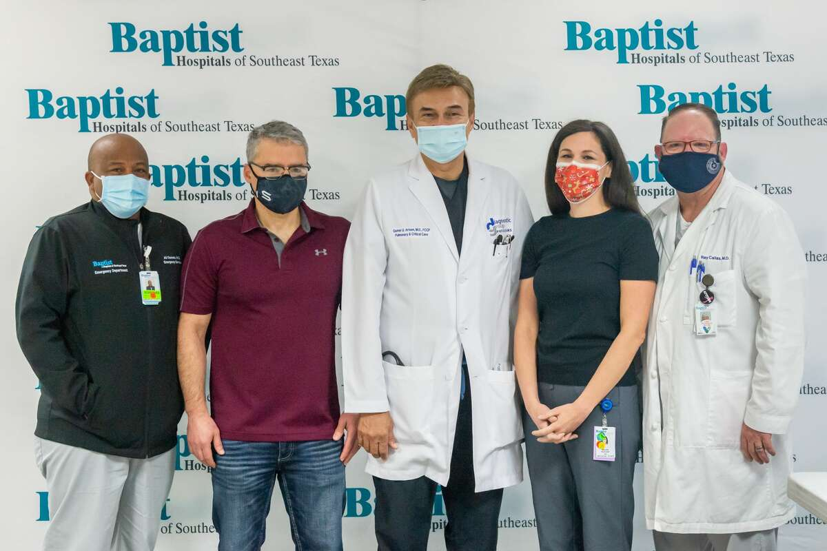Baptist Hospital administered the first of their Covid-19 vaccines to 5 doctors on the pandemic frontlines Friday morning. From left, the doctors are Ali Osman, MD, Orlando Schaening, MD, Qamar Arfeen, MD. Nikki Hancock, MD, and Ray Callas, MD. Photo made on December 18, 2020. Fran Ruchalski/The Enterprise