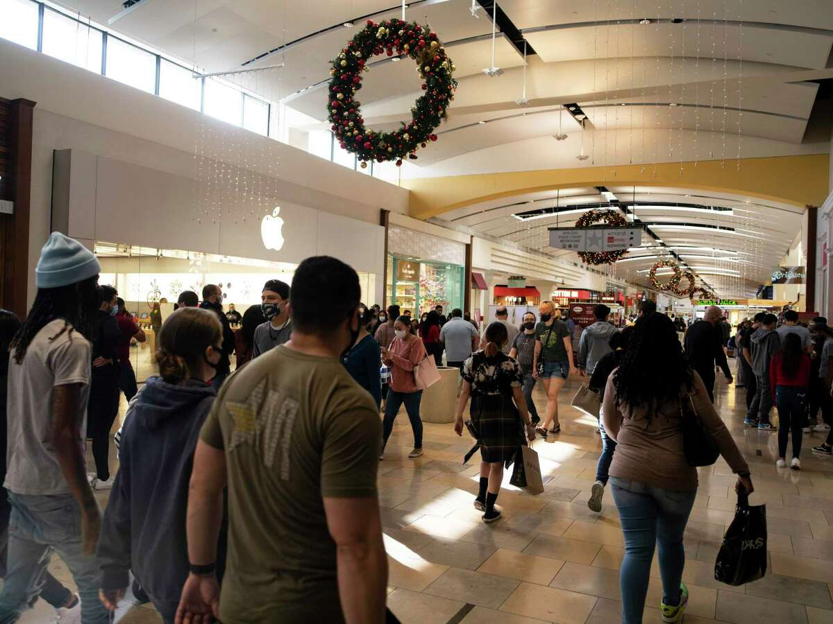 Holiday shoppers make their way through North Park Mall. The National Retail Federation forecasts sales will rise between 3.6 and 5.2 percent in November and December, totaling as much as $766.7 billion.