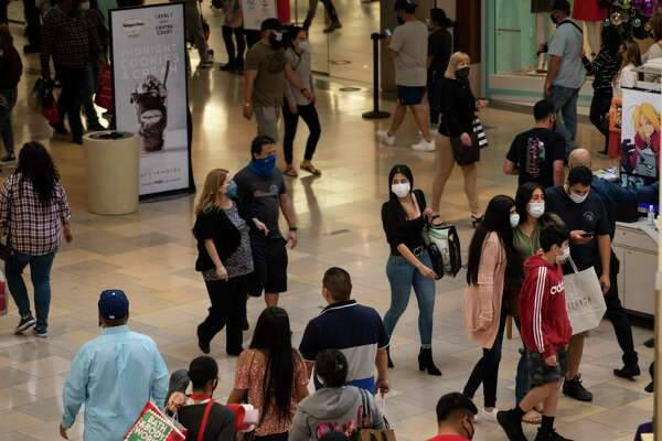 Holiday shoppers make their way through North Park Mall in San Antonio on December 12, 2020.