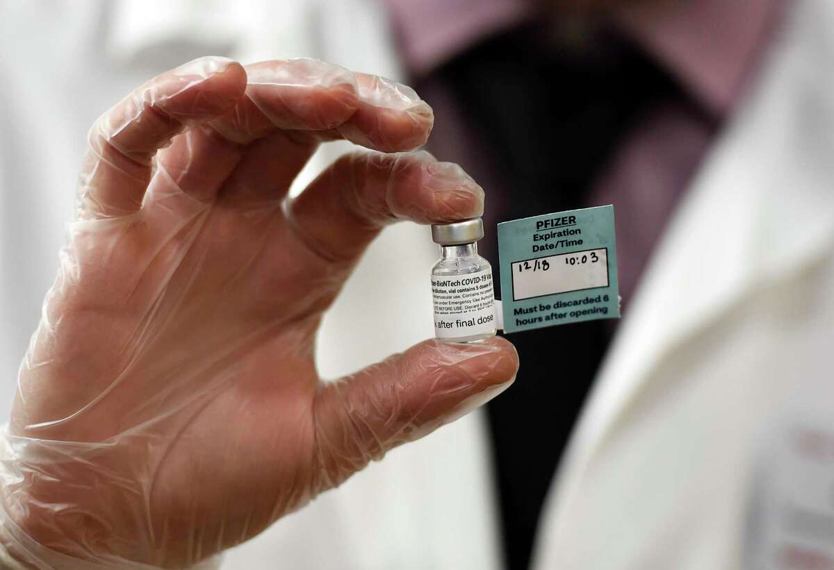 A vial of the Pfizer vaccine used at The Reservoir nursing facility, is shown, Friday, Dec. 18, 2020, in West Hartford, Conn.