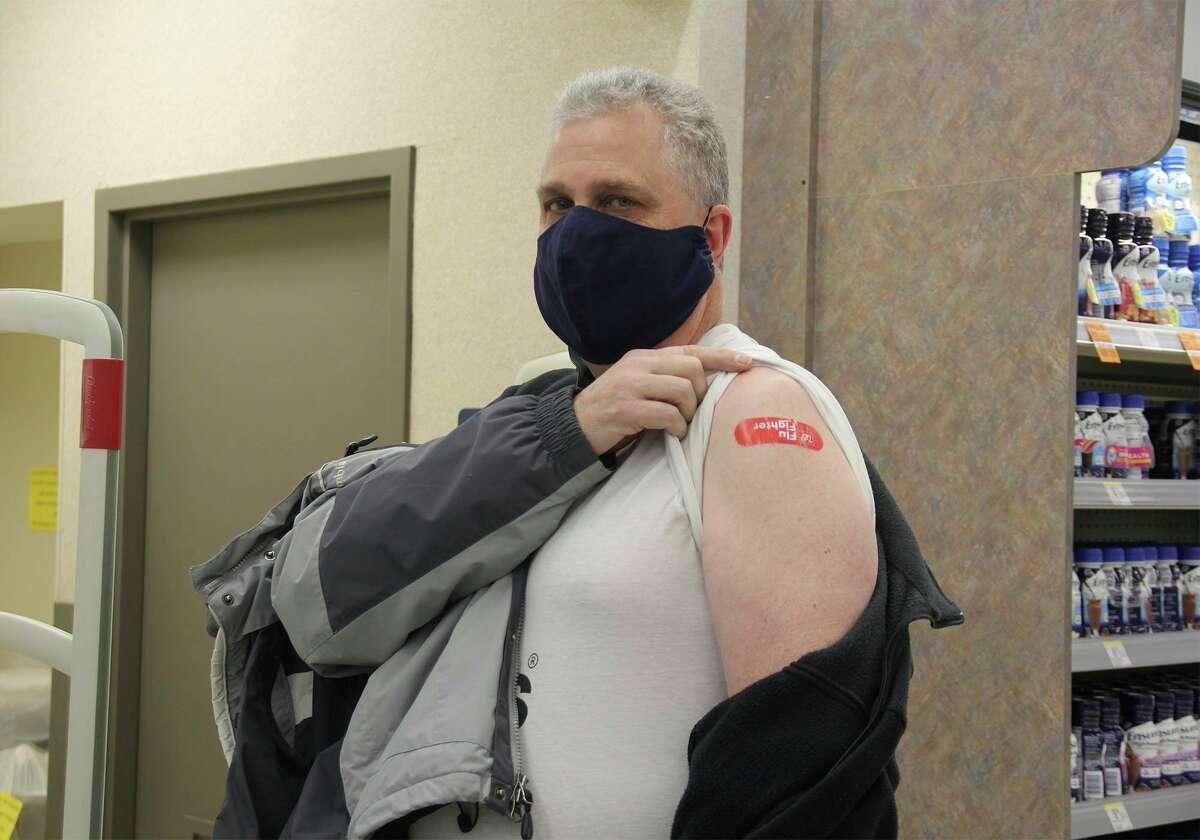Bob Bechtel, a surgical technician for McLaren Thumb Region, shows off where he got his COVID-19 vaccine Friday. McLaren Thumb Region workers can get COVID-19 vaccines through Walgreens. (Robert Creenan/Huron Daily Tribune)