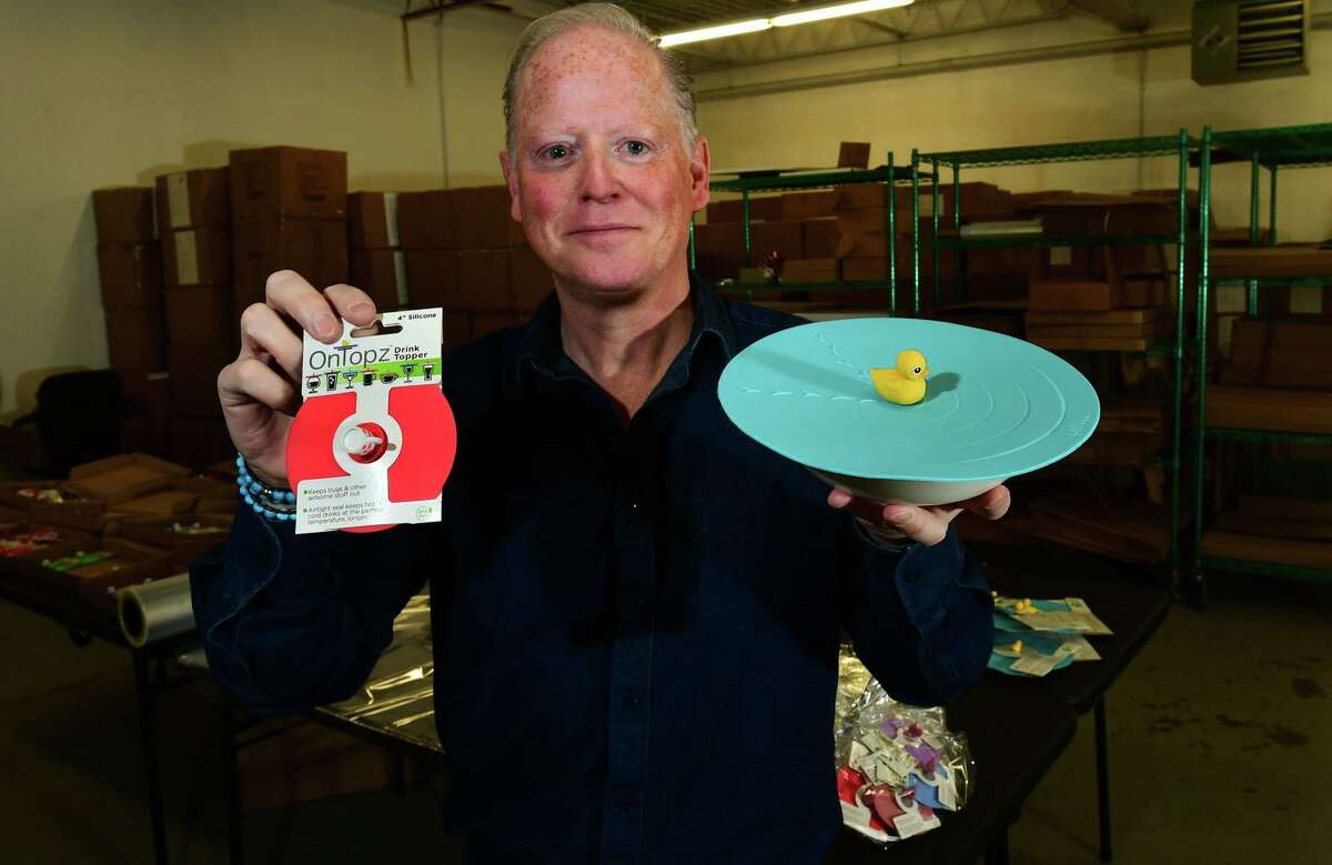 Norwalk resident David Farnworth, CEO and founder of OnTopz, at their facility Wednesday, December 16, 2020, in Norwalk, Conn. OnTopz manufactures round silicone lids that seal the the tops of open beverage glasses and food containers topped by whimsical characters.
