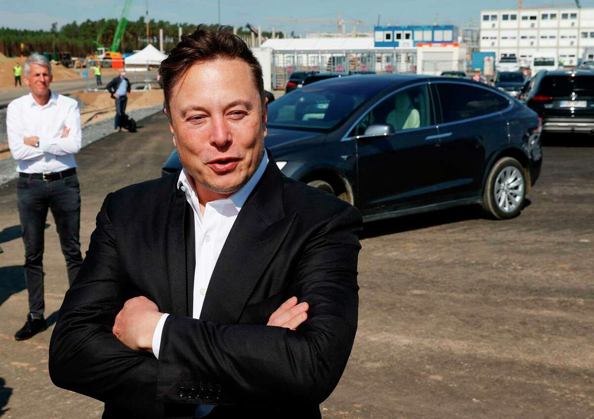 Tesla CEO Elon Musk talks to media as he arrives to visit the construction site of the future US electric car giant Tesla in Gruenheide near Berlin on September 3, 2020.