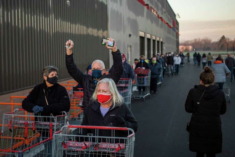 Customers line up to enter the building during a grand opening for the new Costco Thursday, Nov. 12, 2020 at 4816 Bay City Rd. in Midland. (Katy Kildee/kkildee@mdn.net)