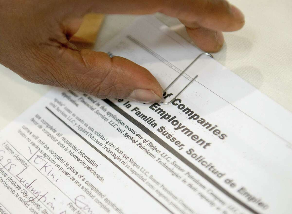 A job seeker fills out an application. More than 89,000 people currently are unemployed in the San Antonio area, up roughly 14,500 from last month, according to the TWC.