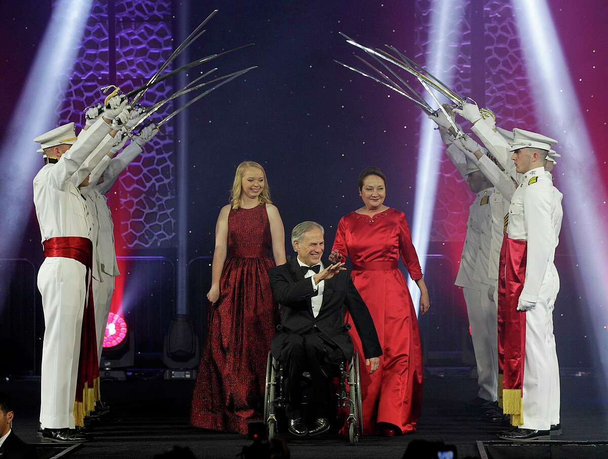 Governor Greg Abbott, his wife, Cecilia and daughter, Audrey, go under The Texas A&M Ross Volunteer saber salute as they take the stage for the Texas Inauguration 2015 Future of Texas Ball at the Austin Convention Center, Tuesday, Jan. 20, 2015. Abbott will serve as the 48th governor of the State of Texas. A crowd of 10,000 was expected to attend the event.