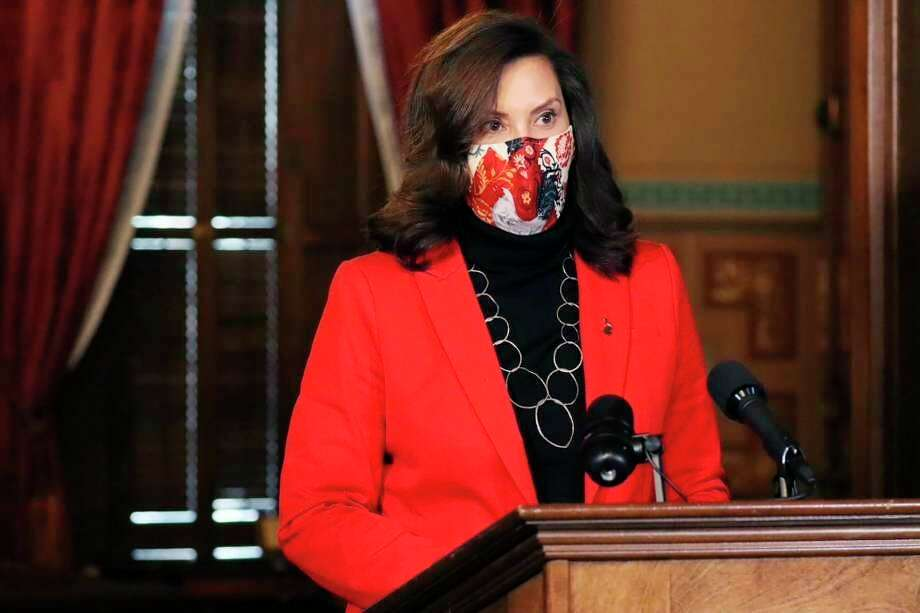 In a photo provided by the Michigan Office of the Governor, Gov. Gretchen Whitmer addresses the state during a speech in Lansing, Mich., Tuesday, Dec. 15, 2020. (AP Photo, File)