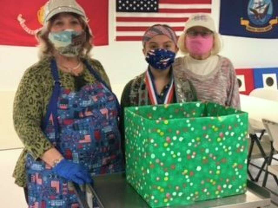 The American Legion Auxiliary Post #10 and the Sons of the Legiondonated candy for Miss Sawyer's Kids with a Cause Christmas stocking cause for active military.Pictured (left to right) areauxiliarypresident Pati Potes, Sawyer Hendrickson and auxiliarychaplain Kathy Yoder. (Courtesy photo)