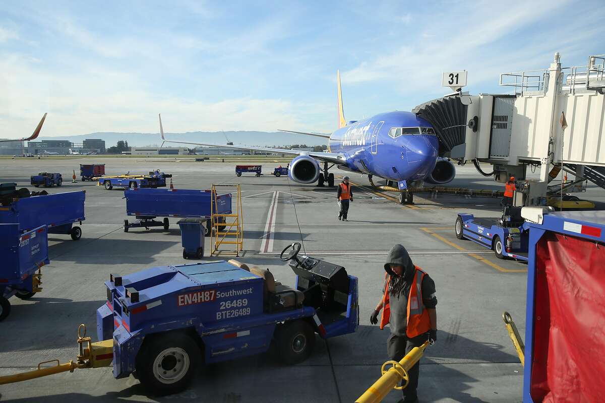 Airport personnel work on the tarmac at San Jose International Airport in January. Rapid coronavirus testing is now available for airport travelers.