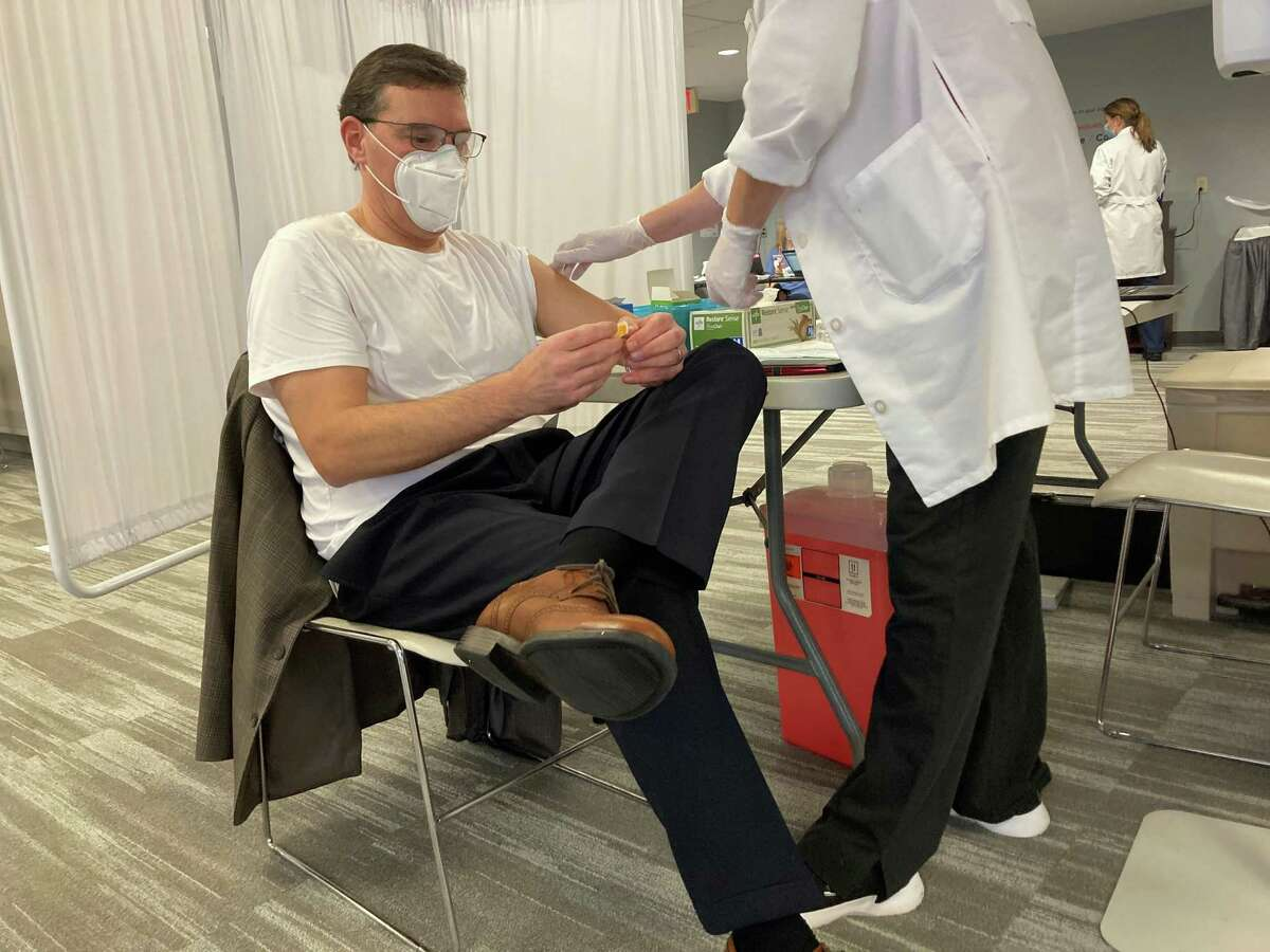Dr. Jason Orlinick, Vice President of Medical Affairs, Chair of the Department of Medicine at Norwalk Hospital gets the COVID-19 vaccine on Friday, Dec. 18, 2020
