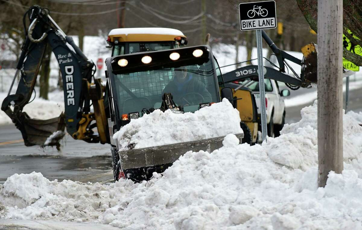 Norwalk DPW crews remove snow from the sidewalks around Ludlowe Park Friday, December 18, 2020, in Norwalk, Conn.