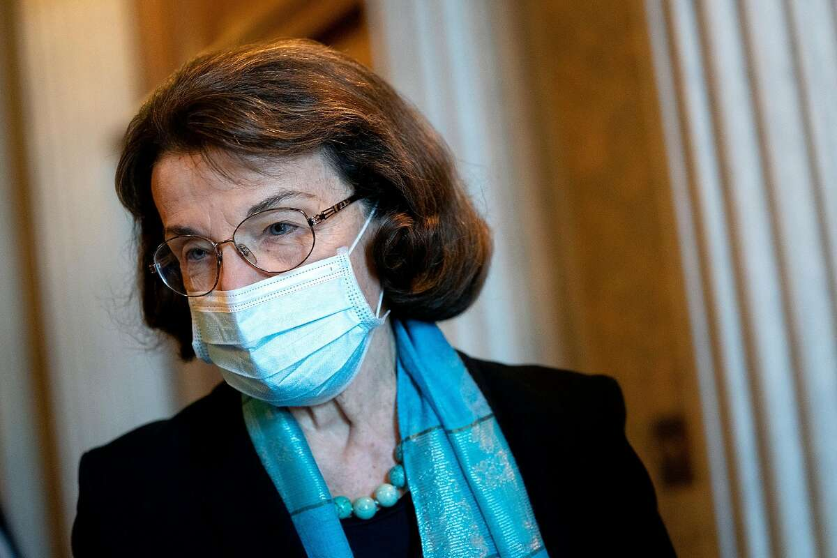 U.S. Sen. Dianne Feinstein (D-CA) wears a protective mask while departing the U.S. Capitol on December 11, 2020 in Washington, DC.