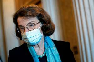 WASHINGTON, DC - DECEMBER 11: U.S. Sen. Dianne Feinstein (D-CA) wears a protective mask while departing the U.S. Capitol on December 11, 2020 in Washington, DC. Lawmakers are facing a midnight deadline to pass a continuing resolution to avert a partial shutdown and fund the government for another week. (Photo by Stefani Reynolds/Getty Images)