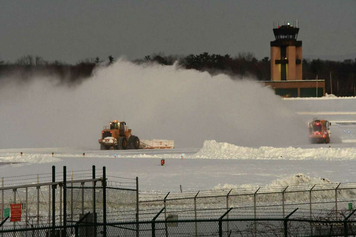 Runways are cleared at the Albany International Airport on Friday Dec. 18, 2020 in Albany, N.Y. The Capital Region was hit hard with two feet of snow yesterday. (Lori Van Buren/Times Union)