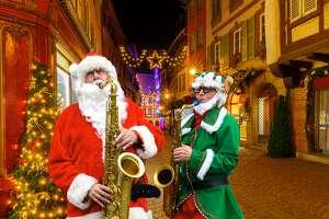 Saxophonist Luke McNamee as Santa Sax with Josh Greenberg, aka Josh the Elf. (Michael Farrell)