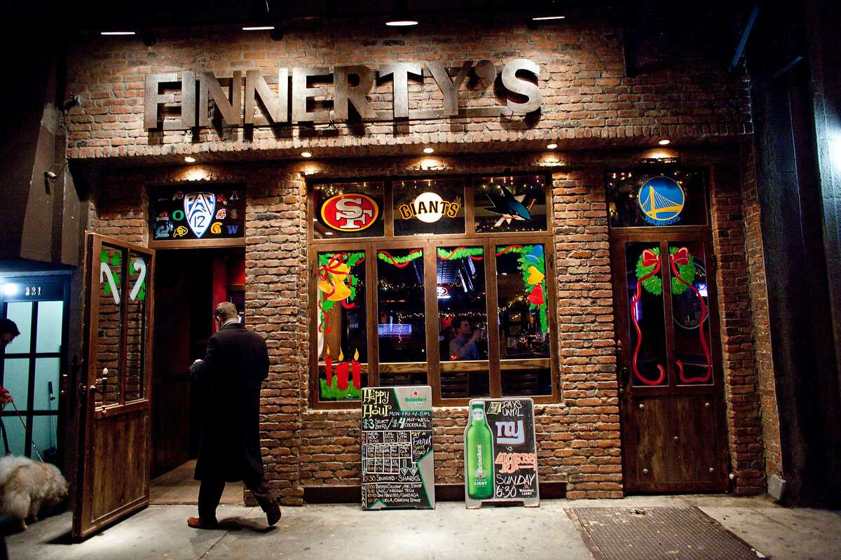 A customer enters Finnerty's, a San Francisco sports bar on in New York, NY, where you could find Hell or High Watermelon in the can and Bay Area fans cheering on their teams.